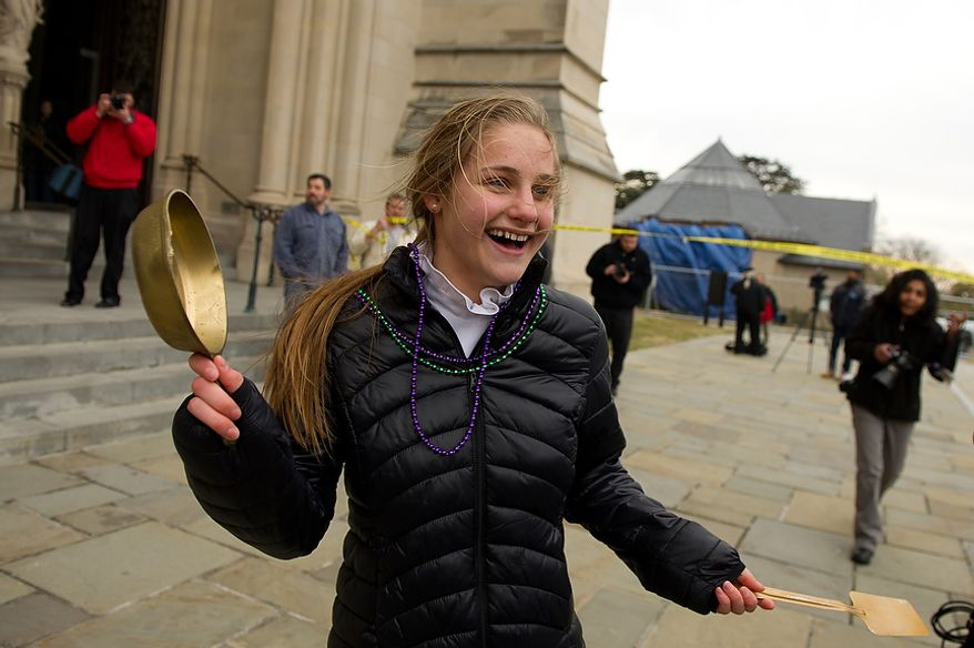 "National Cathedral School student Annabel Ashcom Ricks, 13, gets a ""golden skillet"" for winning her race during the Washington National Cathedral Pancake Races held in front of the Cathedral on Shrove Tuesday, more commonly known as ""Mardi Gras."", Washington, D.C., Tuesday, Feb. 21, 2012. This years annual Pancake Races are entitled the ""Shake, Rattle & Race Edition,†in light of the earthquake damage the cathedral sustained earlier this year. (Andrew Harnik/The Washington Times)"