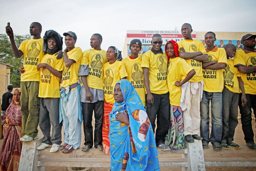 "Supporters of Senegal's president await his arrival for a campaign rally Feb. 10 in the town of Dagana. Abdoulaye Wade says he is in good health and is able to serve another term. ""I still feel like I have the physical and intellectual capacity to serve my people,"" he said. (Associated Press)"