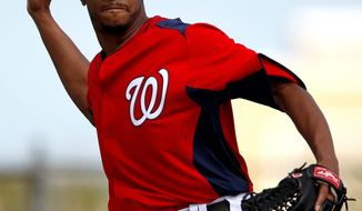 Nationals pitcher Edwin Jackson was found to be making the ball slightly visible when working out of a windup. The team is altering the delivery to make it more uniform with the one he uses out of the stretch. (Associated Press)