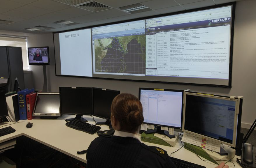 **FILE** A naval officer works Feb. 20, 2012, at the operation room of the EU NAVFOR, the European Union naval force responsible with anti-piracy patrols, at their headquarters in Northwood, England. The force said pirates who target international shipping from the shores in Somalia hijacked six vessels between May and December 2011, compared to 19 between January and April. (Associated Press)