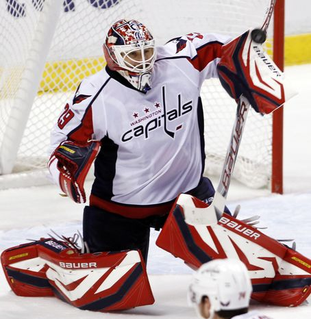 Washington Capitals goaltender Tomas Vokoun allowed four goals on 11 Ottawa Senators shots before being pulled in the second period of the 5-2 loss. (AP Photo/Alan Diaz)