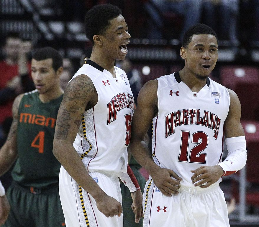Maryland guards Nick Faust and Terrell Stoglin react after Miami turned the ball over in the second half in College Park, Md., Tuesday, Feb. 21, 2012. Maryland won 75-70. (AP Photo/Patrick Semansky)