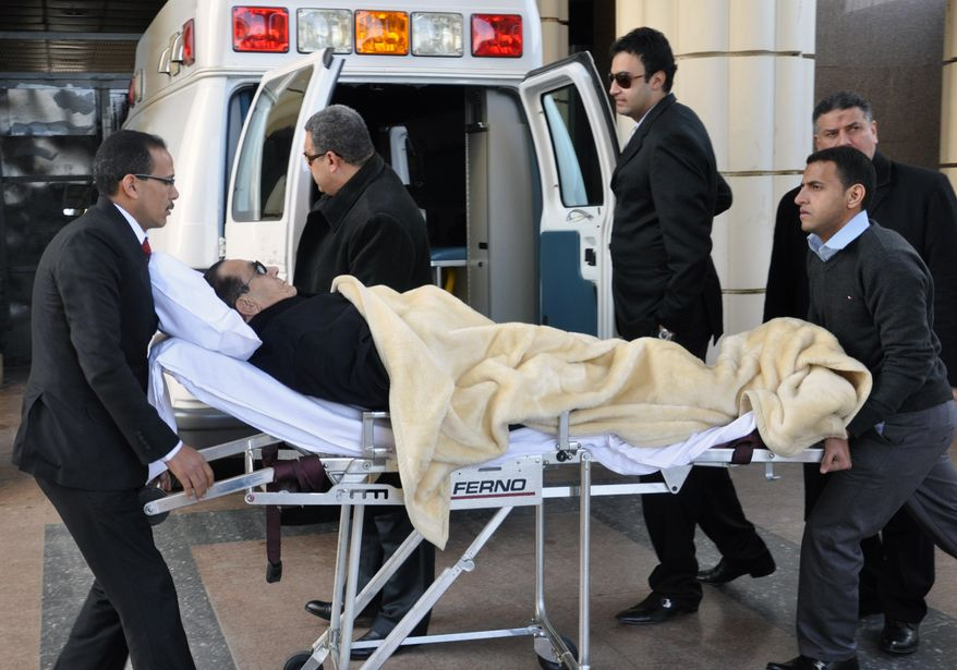 ** FILE ** Former Egyptian President Hosni Mubarak is wheeled into a courthouse in Cairo on Tuesday, Jan. 24, 2012. (AP Photo/Mohammed al-Law, File)