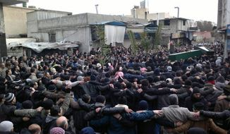 Anti-Syrian regime mourners carry Feb. 18, 2012, the coffins of two protesters that according to Syrian activists were killed by the Syrian security forces during a demonstration at Mazzeh district in Damascus, Syria. (Associated Press/Local Coordination Committees in Syria)
