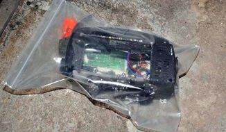 Two radios in which bombs were hidden were found in a rented house in Bangkok, explosive-ordnance disposal officials said. A similar device went off accidentally, severing the legs of one of the terrorism suspects.