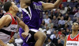 Sacramento center DeMarcus Cousins on Wednesday renewed acquaintances with Washington guard John Wall, who was Cousins' teammate at Kentucky. Cousins scored 16 points in the Kings' 115-107 win. (Associated Press)