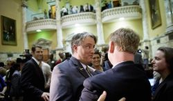 "Maryland state Sen. Richard S. Madaleno Jr. (left) gets a hug from Maryland state Sen. Allan H. Kittleman after the Senate passed the Civil Marriage Protection Act in Annapolis on Thursday. ""It's just a remarkable day for the people of the state of Maryland,"" said Mr. Madaleno, a Montgomery Democrat who is openly gay. (Rod Lamkey Jr./The Washington Times)"