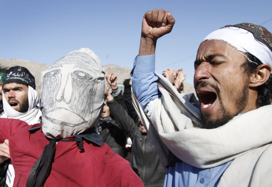 Afghans shout anti-American slogans during a demonstration in Jalalabad, Afghanistan, on Wednesday, Feb. 22, 2012. Protests continued for a third day Thursday over what the U.S. has said was the inadvertent burning of Muslim holy books at a NATO military base. The effigy depicts President Obama. (AP Photo/Rahmat Gul)