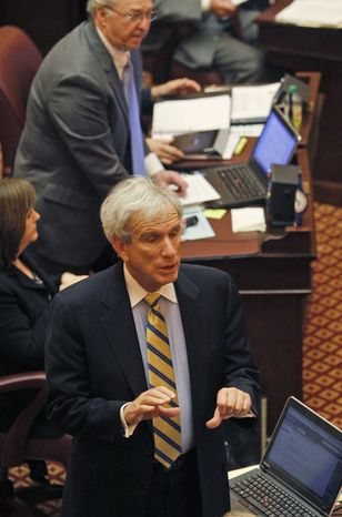 State Sen. Richard Saslaw, Fairfax Democrat, gives a thumbs down signal for the budget vote at the Capitol in Richmond, Va., Thursday, Feb. 23, 2012. There was not a majority on Senators voting for the budget bill which did not pass. (AP Photo/Steve Helber)