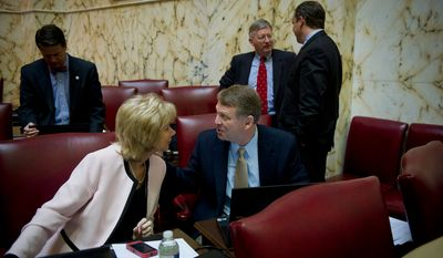 Maryland State Sens. Nancy C. Jacobs, a Republican representing Cecil and Harford counties, and Allan H. Kittleman, a Republican representing Carroll and Howard counties, chat Feb. 23, 2012, at the State House in Annapolis, as the Senate passed the Civil Marriage Protection Act. (Rod Lamkey Jr./The Washington Times)