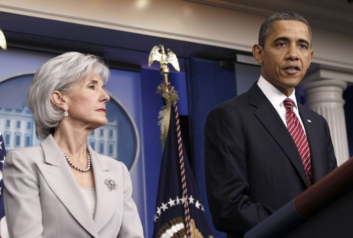**FILE** President Obama, accompanied by Health and Human Services Secretary Kathleen Sebelius, announces the revamp of his contraception policy requiring religious institutions to fully pay for birth control on Feb. 10, 2012, at the White House. (Associated Press)
