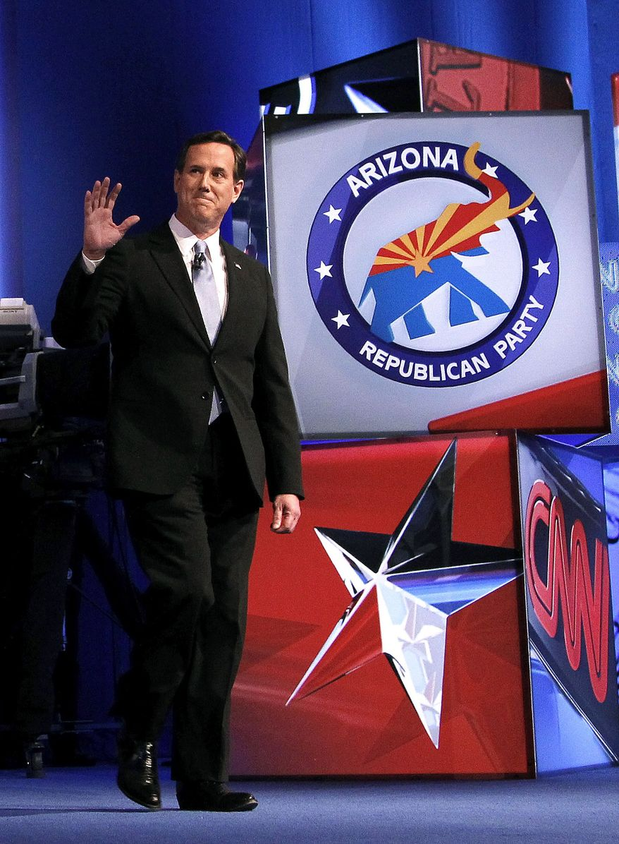 Republican presidential candidate, former Pennsylvania Sen. Rick Santorum, waves to the crowd as he is introduced at the start of a Republican presidential debate among the 2012 candidates Wednesday, Feb. 22, 2012, in Mesa, Ariz. (AP Photo/Ross D. Franklin)