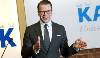 Prince Daniel of Sweden, the husband of Crown Princess Victoria, announces the birth of the couple's first child at the Karolinska University Hospital in Stockholm on Thursday, Feb. 23, 2012. The baby daughter is second in line to the Swedish throne, after her mother. (AP Photo/Jonas Ekstroeme)