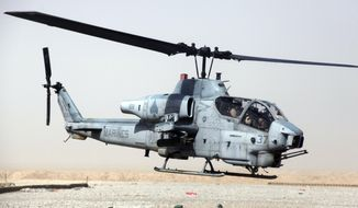 "** FILE ** An AH-1W ""Cobra"" helicopter similar to this one collided with another Marine chopper during night-training exercises on Wednesday, Feb. 22, 2012, near Yuma, Ariz. (AP Photo/US Marines)"