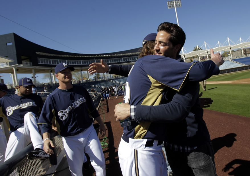 Milwaukee Brewers' Ryan Braun (right) hugs teammate John Axford after a Feb. 24, 2012, news conference at spring training in Phoenix. Braun's 50-game suspension was overturned by baseball arbitrator Shyam Das the previous day, the first time a baseball player successfully challenged a drug-related penalty in a grievance. (Associated Press)