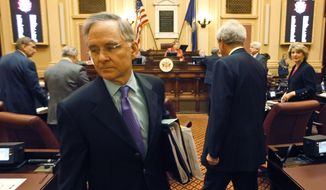 Senate Republican leader, Sen. Thomas Norment, James City Republican, left, and Democratic leader Sen. Richard Saslaw, Fairfax Democrat, leave the Senate floor after a vote on the budget at the Capitol in Richmond, Va., Thursday, Feb. 23, 2012. (AP Photo/Steve Helber)