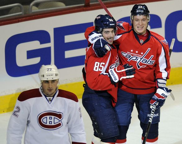 Washington Capitals center Mathieu Perreault celebrates his goal with teammate left wing Alexander Semin as Montreal Canadiens defenseman Tomas Kaberle looks on during the first period Friday, Feb. 24, 2012, in Washington. (AP Photo/Nick Wass)