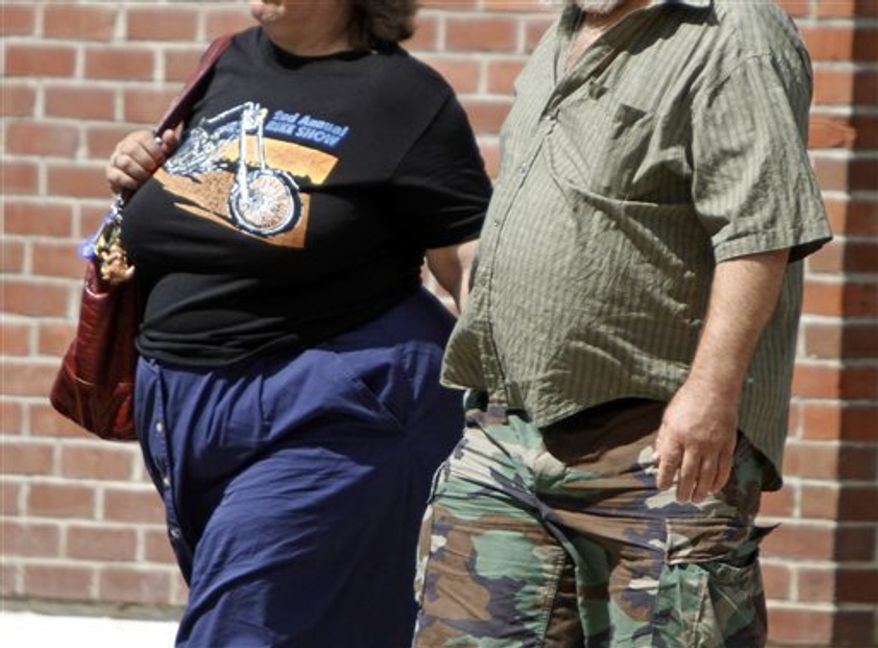 Pedestrians are pictured in Montpelier, Vt., in July 2011. For nearly a century, scientists have struggled to come up with a diet pill that helps people lose weight without causing side effects that range from embarrassing digestive issues to dangerous heart problems. (AP Photo/Toby Talbot)
