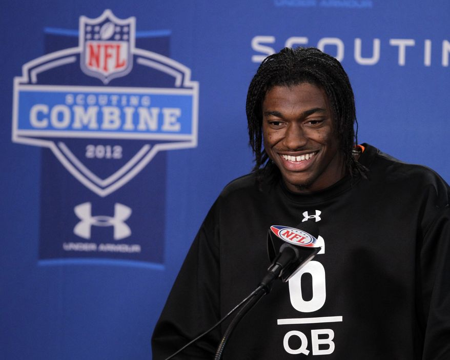Baylor quarterback Robert Griffin III laughs as he answers a question during a news conference at the NFL scouting combine in Indianapolis, Friday, Feb. 24, 2012. (AP Photo/Michael Conroy)