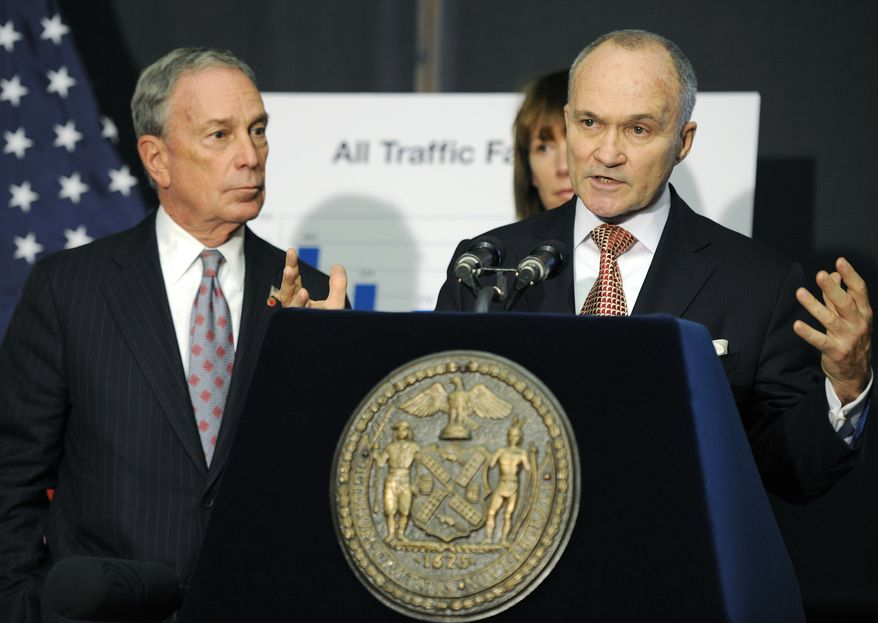**FILE** New York City Police Commissioner Ray Kelly (right) speaks Dec. 29, 2011, at a news conference with New York Mayor Michael Bloomberg in the Brooklyn borough of New York. (Associated Press)