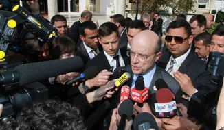 French foreign minister Alain Juppe addresses reporters Feb. 24, 2012, outside the Cartago hotel in Tunis, Tunisia, the site of a landmark conference on Syria by high-level U.S., European, Turkish and Arab League officials. (Associated Press)