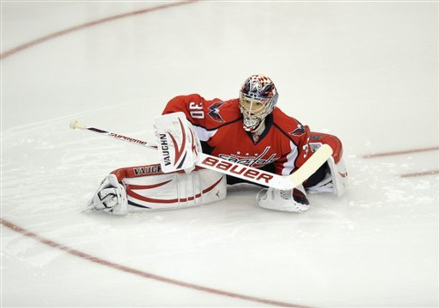 Michal Neuvirth made 30 saves on 31 shots in beating the Canadiens on Friday night. Associated Press / Nick Wass