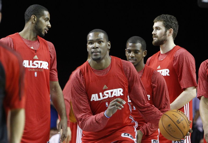 Oklahoma city Thunder's Kevin Durant, center, prepares to shoot during practice for the NBA All Star basketball game, Saturday, Feb. 25, 2012, in Orlando, Fla. (AP Photo/Lynne Sladky)
