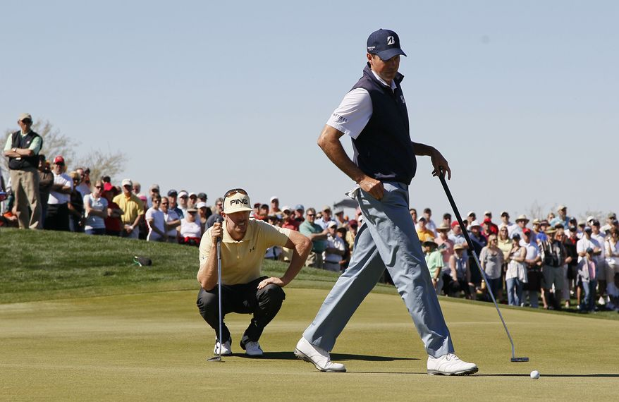 Hunter Mahan, left, and Matt Kuchar line up their putts on the seventh green while playing in the quarterfinal round during the Match Play Championship golf tournament, Saturday, Feb. 25, 2012, in Marana, Ariz. (AP Photo/Matt York)