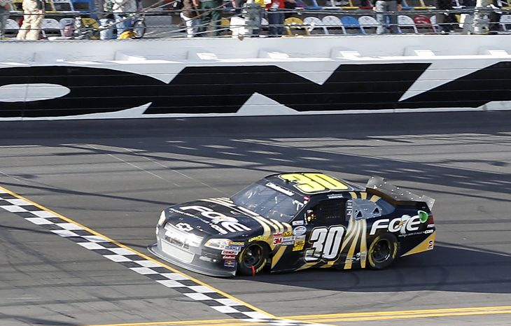 James Buescher crosses the finish line to win the Nationwide Series NASCAR Drive4COPD 300 auto race at Daytona International Speedway in Daytona Beach, Fla., Saturday, Feb. 25, 2012. (AP Photo/Terry Renna)
