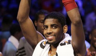 Cleveland Cavaliers' Kyrie Irving, of Team Chuck, holds the MVP trophy following the NBA All-Star Rising Stars Challenge in Orlando, Fla. Friday, Feb. 24, 2012. Team Chuck defeated Team Shaq 146-133. (AP Photo/Chris O'Meara)
