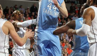North Carolina forward Tyler Zeller shoots the ball next to Virginia forward Akil Mitchell during the first half on Saturday, Feb. 25, 2012, in Charlottesville, Va. (AP Photo/Andrew Shurtleff)