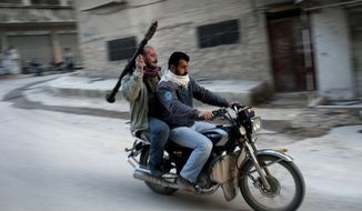 Supporters of the Free Syrian Army ride a motorcycle with a rocket-propelled grenade in Kafar Taharim, Syria, Friday, Feb. 24., 2012. (AP Photo/Rodrigo Abd)