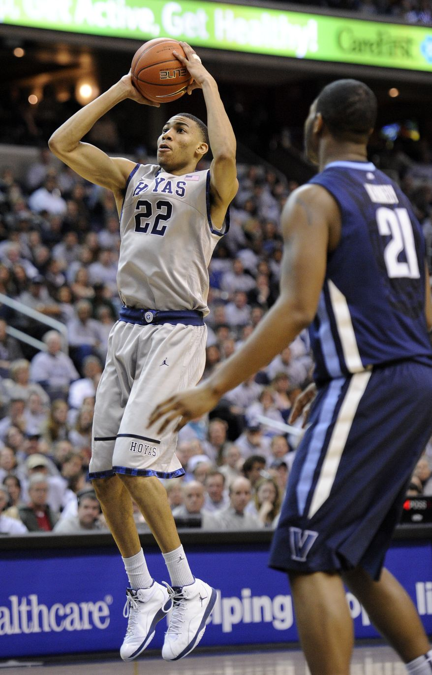 Georgetown forward Otto Porter takes a shot against Villanova forward Markus Kennedy during the second half Saturday, Feb. 25, 2012, in Washington. Georgetown won 67-46. (AP Photo/Nick Wass)
