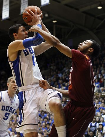Duke's Austin Rivers shoots while Virginia Tech's Marquis Rankin defends during the first half in Durham, N.C., Saturday, Feb. 25, 2012. (AP Photo/Gerry Broome)