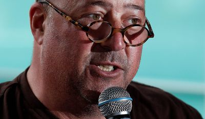"""Celebrity chef Andrew Zimmern moderates a panel discussion called """"Girls Gone Wild"""" about women in the celebrity cooking world at the South Beach Wine and Food Festival in Miami on Saturday. He said his plans include running for public office in Minnesota. (Associated Press)"""