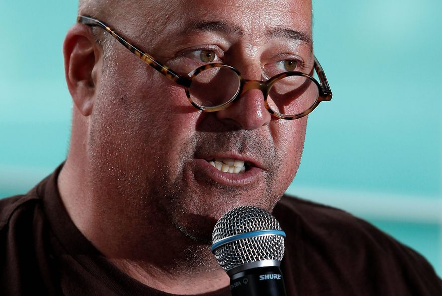 "Celebrity chef Andrew Zimmern moderates a panel discussion called ""Girls Gone Wild"" about women in the celebrity cooking world at the South Beach Wine and Food Festival in Miami on Saturday. He said his plans include running for public office in Minnesota. (Associated Press)"