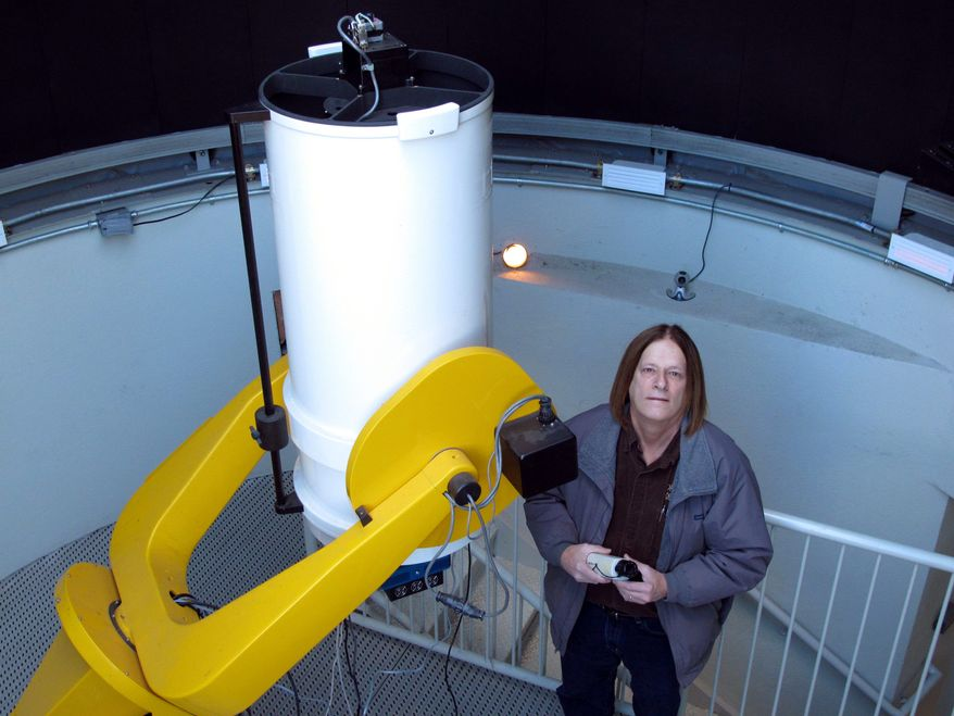 Astronomy professor Daniel Caton stands next to a low-light video camera at Appalachian State University in Boone, N.C. He hopes to use the cameras to capture a phenomenon known as the Brown Mountain Lights. (Associated Press)