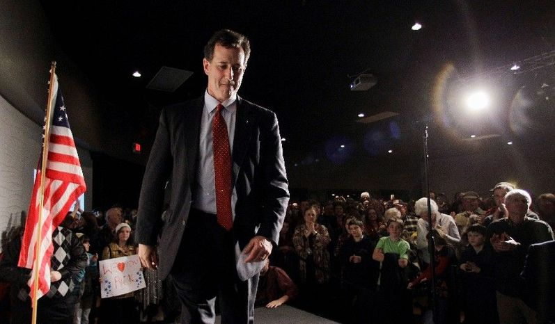 Former Sen. Rick Santorum of Pennsylvania, a GOP presidential hopeful, walks off stage after speaking at a rally in Traverse City, Mich., on Sunday. (Associated Press)
