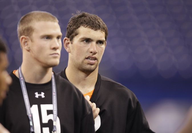Stanford quarterback Andrew Luck, right, and Texas A&M quarterback Ryan Tannehill at the NFL football scouting combine in Indianapolis, Sunday, Feb. 26, 2012. (AP Photo/Michael Conroy)