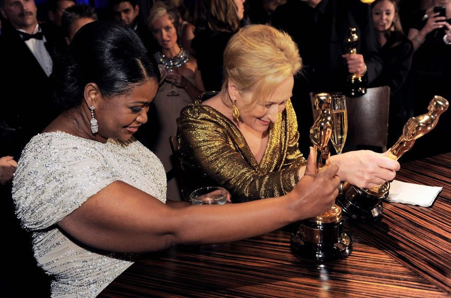 Best supporting actress Octavia Spencer and best leading actress Meryl Streep examine their trophies at the Governors Ball, the Academy Awards' official after-party. (Associated Press)