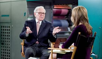 "Billionaire inverstor Warren Buffett chairman and CEO of Berkshire Hathaway, is interviewed by Becky Quick, co-host of CNBC's ""Squawk Box,"" on the floor of the Omaha World-Herald's press room Monay Feb. 27, 2012, in Omaha Neb. Buffett said Monday that stocks remain relatively cheap compared to other investments as the economy continues to improve. He also said that the company he heads is prepared to replace him whenever the need arises. (AP Photo/The Omaha World-Herald, Jeff Beiermann)"