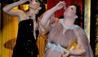 "Members of the cast of ""Bridesmaids"" Rose Byrne and Melissa McCarthy drink a toast to Martin Scorsese as they present an award during the 84th Academy Awards on Sunday, Feb. 26, 2012, in the Hollywood section of Los Angeles. (AP Photo/Mark J. Terrill)"