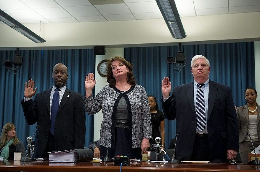 Officials of the Children and Youth Investment Trust Corp. being sworn in Monday before a D.C. Council committee are (from the left) Vice President Ed Davies, President and CEO Ellen London and Comptroller Michael O'Hearn. Former council member Harry Thomas Jr. used the nonprofit as a conduit to steal city funds. (Barbara L. Salisbury/The Washington Times)