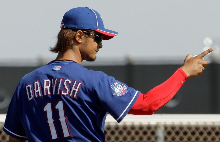 Texas' Yu Darvish threw 34 pitches to a pair of minor league players during a workout Monday in Surprise, Ariz. (Associated Press)