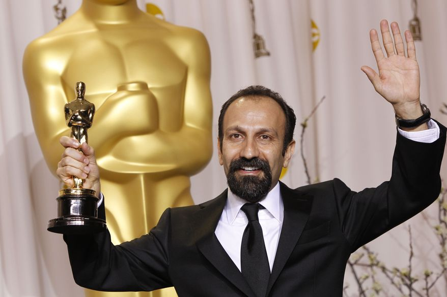 "Asghar Farhadi, of Iran, poses Feb. 26, 2012, with his award for best foreign language film for ""A Separation"" during the 84th Academy Awards in Los Angeles. (Associated Press)"