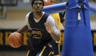 In this Tuesday, Feb. 21, 2012 photo, Drexel's Frantz Massenat practices in Philadelphia. The Dragons, on a 17-game winning streak, hope their record is strong enough to earn NCAA tournament consideration. (AP Photo/Matt Rourke)