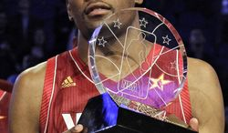 Kevin Durant of the Oklahoma City Thunder hoists the Most Valuable Player trophy following the NBA All-Star Game on Sunday, Feb. 26, 2012, in Orlando, Fla. The Western Conference won 152-149. (AP Photo/Chris O'Meara)