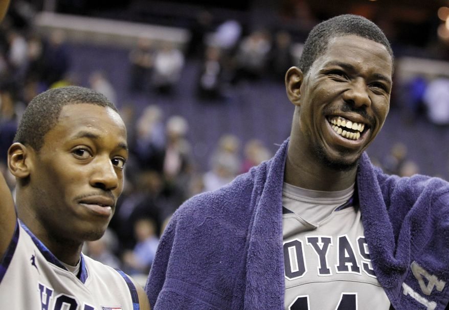 "Georgetown's Jason Clark, left, and Henry Sims smile as they are acknowledged by the crowd for their combined for 25 points, 12 rebounds and six assists on ""Senior Day,"" following their game against Notre Dame, Monday, Feb. 27, 2012, in Washington. Georgetown won 59-41. (AP Photo/Haraz N. Ghanbari)"