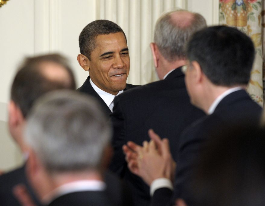 President Obama greets guests before speaking to the National Governors Association on Monday, Feb. 27, 2012, in the State Dining Room of the White House in Washington. (AP Photo/Susan Walsh)