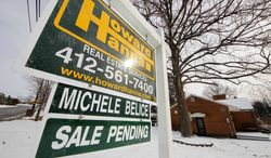 This photo from Jan. 20, 2012, shows a home with a sale pending sign, in Mount Lebanon, Pa. (Associated Press)